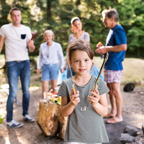 beautiful-family-camping-in-forest-eating-PDBGT8D_1800x1200.jpg
